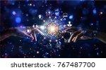 hands touching global... | Shutterstock . vector #767487700
