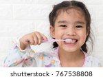 little asian cute girl brush... | Shutterstock . vector #767538808