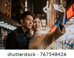 young japanese couple spending... | Shutterstock . vector #767548426