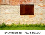 Yellow And Red Brick Wall With...
