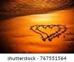 sunset beach under warm light.... | Shutterstock . vector #767551564