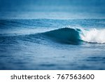 ocean wave breaking on shore | Shutterstock . vector #767563600