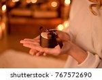 christmas gift in women's hands   Shutterstock . vector #767572690