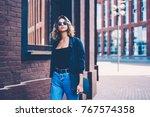 pensive female in sunglasses... | Shutterstock . vector #767574358