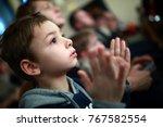 portrait of a boy applauding in ... | Shutterstock . vector #767582554
