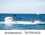 silhouette of a fly board rider ... | Shutterstock . vector #767591410