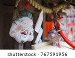 the mask hanging on japanese shrine that is located at Nonomiya Jinja in Arashiyama