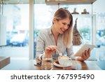 beautiful young smiling woman... | Shutterstock . vector #767595490