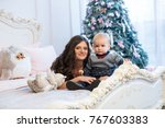 mother with baby on the bed on... | Shutterstock . vector #767603383