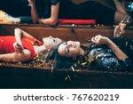 two beautiful relaxed women... | Shutterstock . vector #767620219