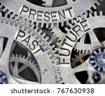 Small photo of Macro photo of tooth wheel mechanism with PAST, PRESENT and FUTURE words imprinted on metal surface