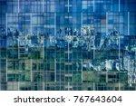 glass facade of a modern... | Shutterstock . vector #767643604