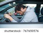man falling asleep in car after ... | Shutterstock . vector #767650576