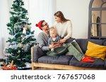 lovely family sharing digital... | Shutterstock . vector #767657068