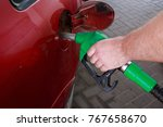 car fill with gasoline at a gas ... | Shutterstock . vector #767658670
