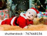 happy pretty baby lying on...   Shutterstock . vector #767668156