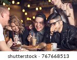 people drinking coffee in cafe... | Shutterstock . vector #767668513