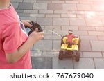 the boy is controling the toy... | Shutterstock . vector #767679040