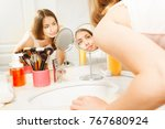 beautiful woman cleaning her... | Shutterstock . vector #767680924