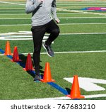 a runner performes speed drills ... | Shutterstock . vector #767683210