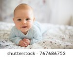 adorable baby boy in white... | Shutterstock . vector #767686753