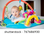 cute baby boy on colorful gym ... | Shutterstock . vector #767686930