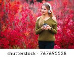 young woman with music player.... | Shutterstock . vector #767695528