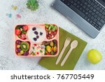 open lunch box with healthy... | Shutterstock . vector #767705449