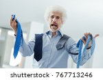 stressed businessman holding a... | Shutterstock . vector #767713246