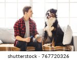 young person with dog at home... | Shutterstock . vector #767720326