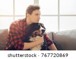 young person with dog at home... | Shutterstock . vector #767720869