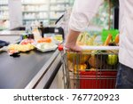 man buying food products in the ... | Shutterstock . vector #767720923