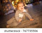happy baby on room with... | Shutterstock . vector #767735506
