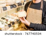 seller holding a peace of blue... | Shutterstock . vector #767740534