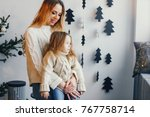 mother and daughter sitting by... | Shutterstock . vector #767758714
