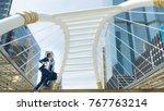 business man run with laptop... | Shutterstock . vector #767763214