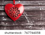 red metal christmas heart on... | Shutterstock . vector #767766058