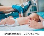 doctor and little boy patient.... | Shutterstock . vector #767768743