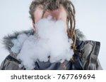 man dreadlocks smoking... | Shutterstock . vector #767769694