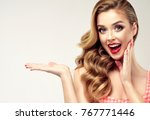 woman surprise showing product .... | Shutterstock . vector #767771446