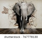 elephant coming out of the wall.... | Shutterstock . vector #767778130