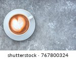 hot coffee in a white cup on... | Shutterstock . vector #767800324