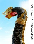 Small photo of Black and Golden colors of Beautiful Molding of Praya Nark showing in Thai Temple Praya Nark or Naga is fabulous serpent or serpent dragon the big snake in Thai story on blue sky background from Thail