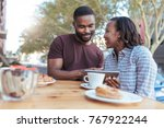 smiling young african couple... | Shutterstock . vector #767922244