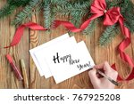 the hand writing text happy new ... | Shutterstock . vector #767925208
