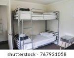 white plain bunk bed in... | Shutterstock . vector #767931058
