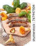 grilled sausages with... | Shutterstock . vector #767947504