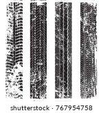 grunge tire track silhouette... | Shutterstock .eps vector #767954758