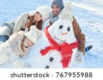 happy family with snowman on... | Shutterstock . vector #767955988