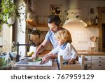 young father with a toddler boy ... | Shutterstock . vector #767959129